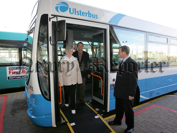 Under the watchful eye of Ulsterbus driver Pat Malone, Rita Morrison and Ulsterbus District Manager Greg McLaughlin try out one of the five new, low floor buses which have been added to the fleet as part of Translink's overall order of 110 new veichles. 06W41N4
