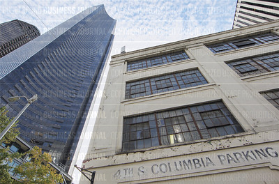The Columbia Center 76-story skyscraper towers over the 4th Avenue and Columbia Street building in Seattle, Washington