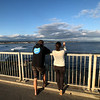 A couple watching the surfers at Steamer Lane, considered one of the top spots in the US to surf