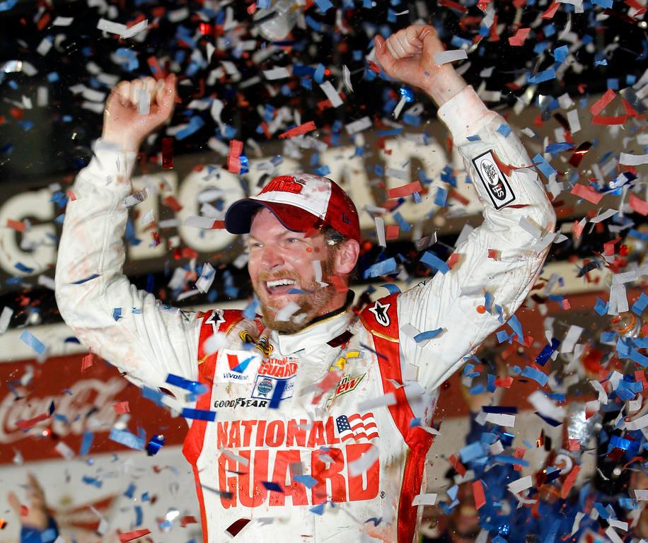 . Dale Earnhardt Jr. celebrates in Victory Lane after winning the NASCAR Daytona 500 Sprint Cup series auto race at Daytona International Speedway in Daytona Beach, Fla., Sunday, Feb. 23, 2014. (AP Photo/Terry Renna)