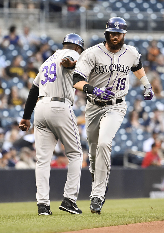 . SAN DIEGO, CA - SEPTEMBER 24:  Charlie Blackmon #19 of the Colorado Rockies, right, is congratulated by Stu Cole #39 after hitting a solo home run during the first inning of a baseball game against the San Diego Padres at Petco Park September, 24, 2014 in San Diego, California.  (Photo by Denis Poroy/Getty Images)