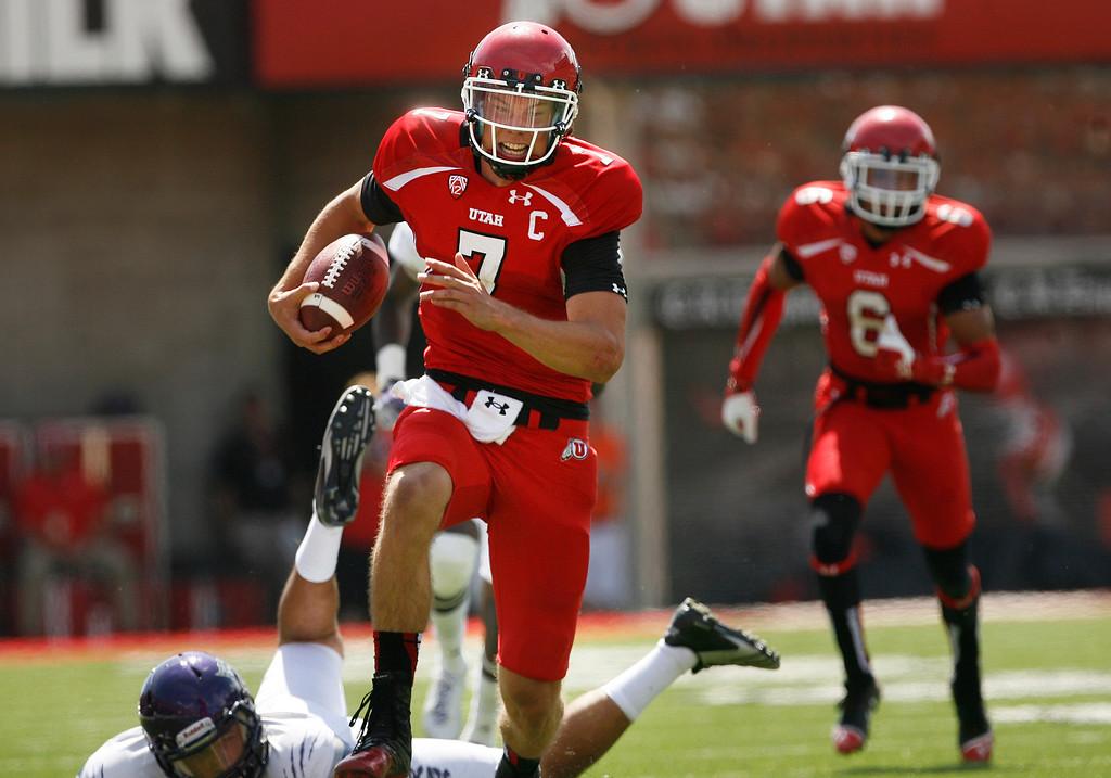 . Utah quarterback Travis Wilson (7) runs for a 51-yard touchdown against Weber State during an NCAA college football game on Saturday, Sept. 7, 2013 in Salt Lake City.  Utah defeated Weber State 70-7.  (AP Photo/The Salt Lake Tribune, Scott Sommerdorf)