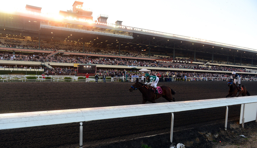 . Final day of horse racing at Hollywood Park in Inglewood, CA on Sunday, December 22, 2013. After 75 years, the famed racetrack is closing to make way for development.  Rafael Bejarano rides Koukla to victory in the 8th race. (Photo by Scott Varley, Daily Breeze)