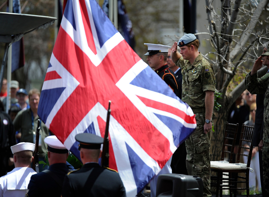 . COLORADO SPRINGS, CO - MAY 11: Prince Harry of Wales salutes Britain\'s  flag during opening ceremonies for the 2013 Warrior Games at the United States Olympic Training Center  Saturday afternoon, May 11th, 2013.(Photo By Andy Cross/The Denver Post)