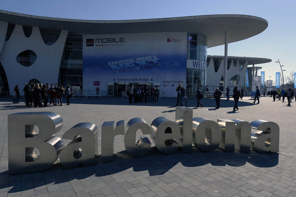 . Visitors arrive at the 2014 the Mobile World Congress centre in Barcelona, on February 23, 2014.  The Mobile World Congress runs from the 24 to 27 February where participants and visitors alike can attend conferences, network, discover cutting-edge products and technologies at among the 1,700 exhibitors as well as seek industry opportunities and make deals.  LLUIS GENE/AFP/Getty Images