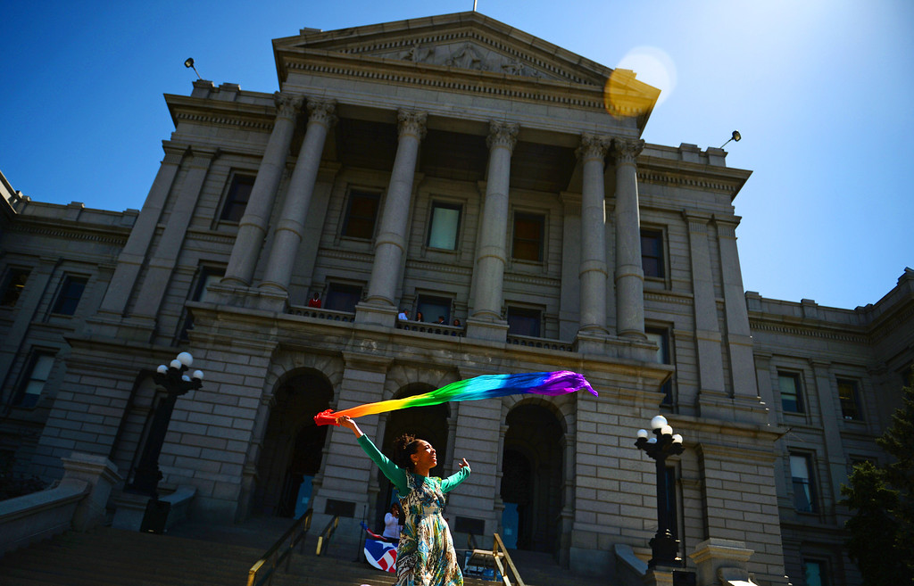 . DENVER, CO - MAY 01: Tamika Shambe dances during a celebration for the National Day of Prayer outside the Colorado State Capitol in Denver, May 01, 2014. The National Day of Prayer is celebrated on the first Thursday of May. (Photo by RJ Sangosti/The Denver Post)