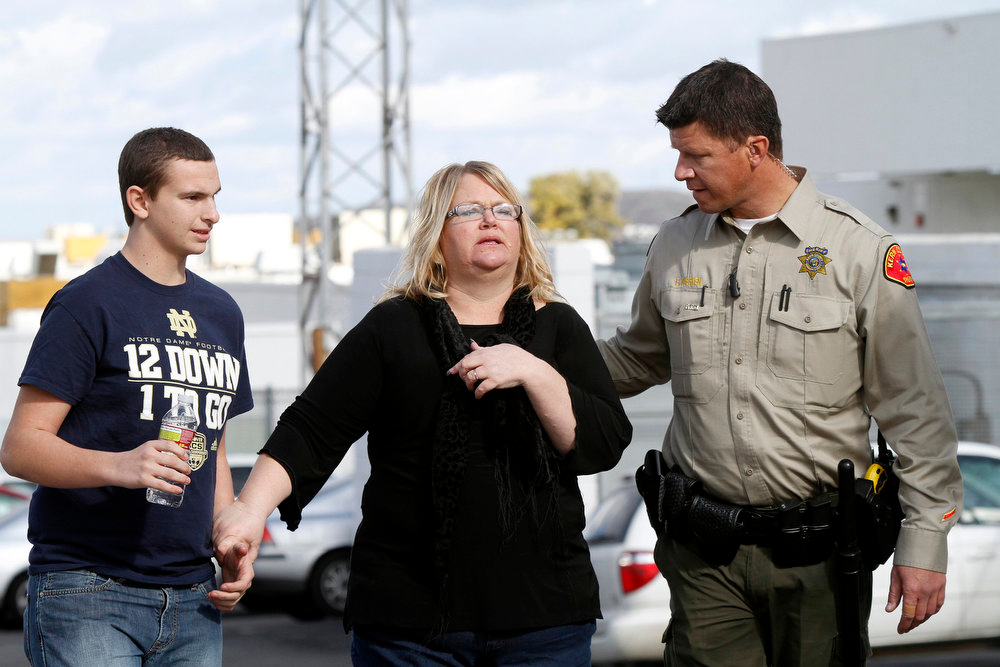 . A Kern County Sheriff\'s deputy escorts a teacher from Taft Union High School in Kern County, California, on Thursday, January 10, 2013, after a student opened fire in a classroom. (Irfan Khan/Los Angeles Times/MCT)