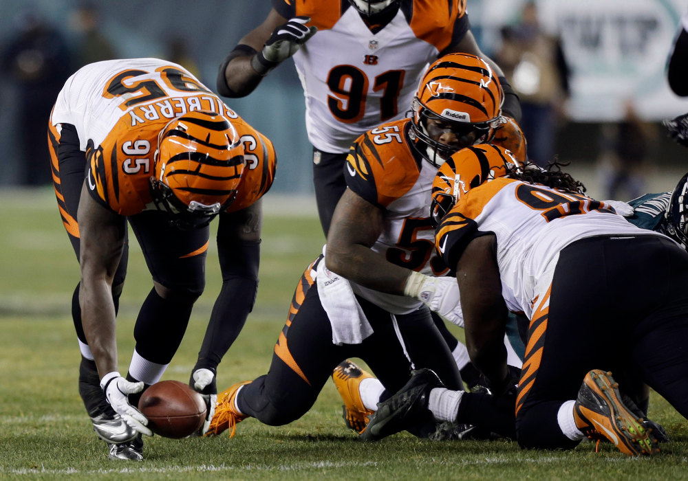 Description of . Cincinnati Bengals' Wallace Gilberry, left, recovers a fumble by the Philadelphia Eagles in the second half of an NFL football game, Thursday, Dec. 13, 2012, in Philadelphia. Gilberry returned the fumble for a touchdown. (AP Photo/Mel Evans)