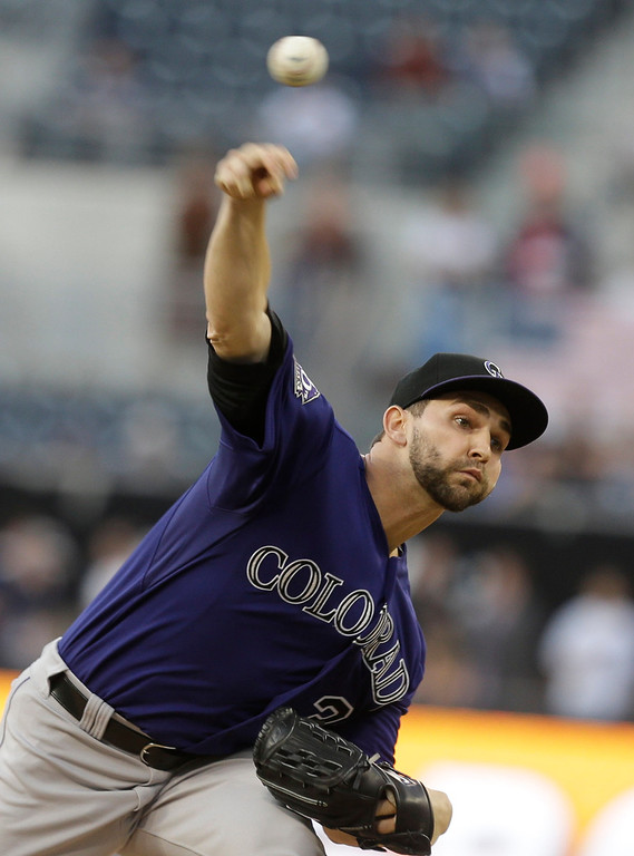 . Colorado Rockies starting pitcher Tyler Chatwood works against the San Diego Padres in the first inning of a baseball game in San Diego, Monday, July 8, 2013. (AP Photo/Lenny Ignelzi)