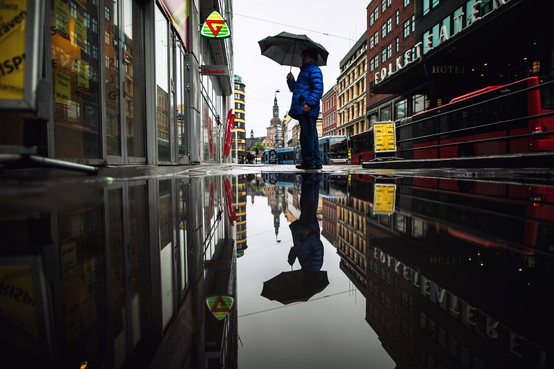 oslo umbrella man reflection.jpg
