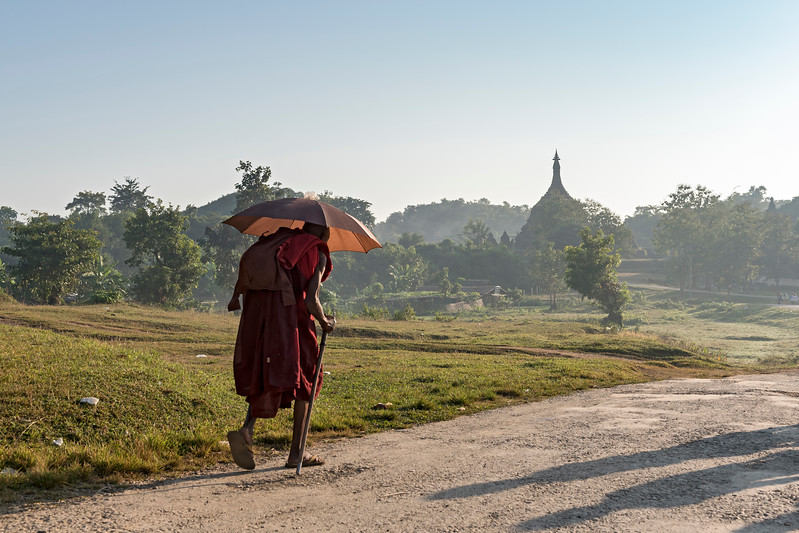 Buddhist monk with umbrella, Mrauk U, Burma