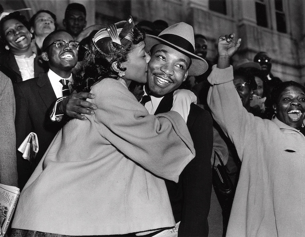 . The Rev. Martin Luther King Jr. is welcomed with a kiss by his wife Coretta after leaving court in Montgomery, Ala., March 22, 1956.  King was found guilty of conspiracy to boycott city buses in a campaign to desegregate the bus system, but a judge suspended his $500 fine pending appeal. (AP Photo/Gene Herrick)