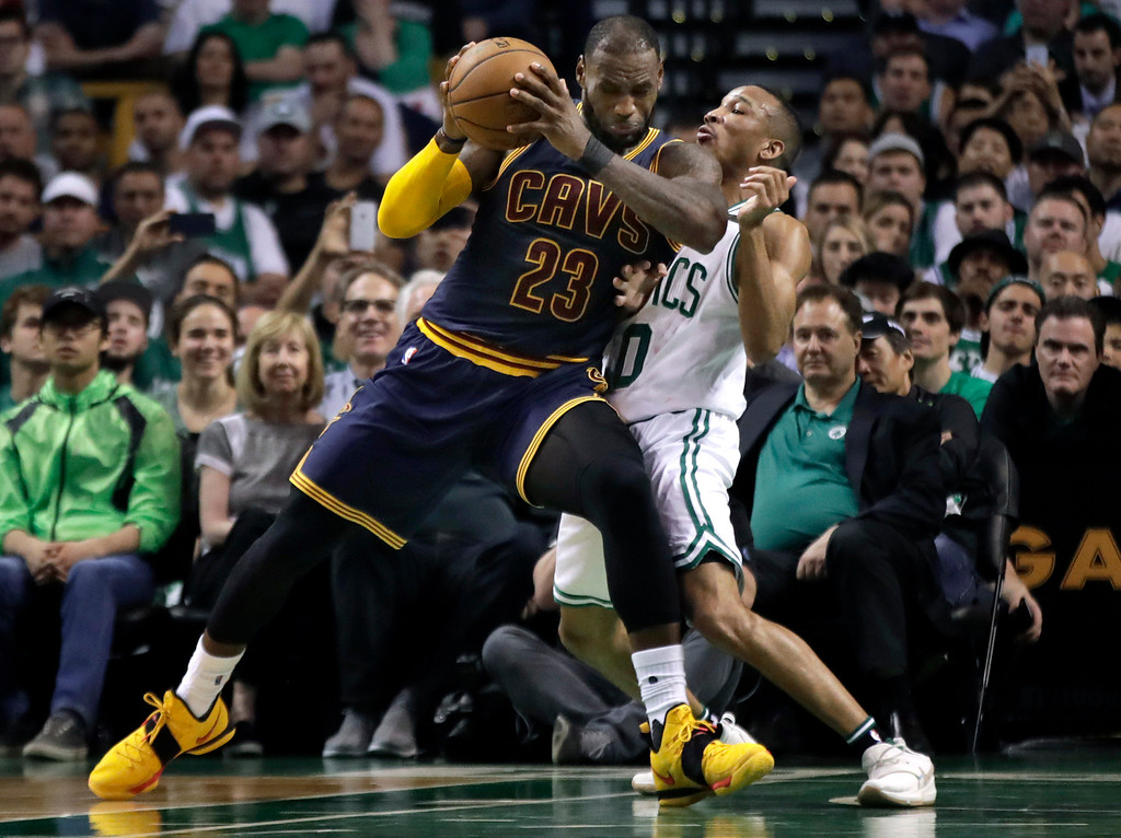 . Cleveland Cavaliers forward LeBron James muscles his way to the basket as Boston Celtics guard Avery Bradley, right, tries to defend during first half of Game 2 of the NBA basketball Eastern Conference finals, Friday, May 19, 2017, in Boston. (AP Photo/Elise Amendola)