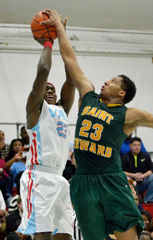 . Jeff Forman/JForman@News-Herald.com Marsalis Hamilton, St. Edward, blocks a shot by Deandre Forte, VASJ, in the second quarter of the Vikings\' 82-76 loss Feb. 20 at Villa Angela-St. Joseph High School.
