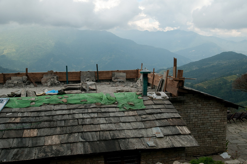 Nepalese save on nails by puting rocks on top of the roof