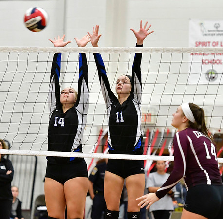 10/30/2019 Mike Orazzi | StaffnBristol Eastern's Ariana Caucci (14) and Ryley Plourde (11) during Wednesday night's volleyball match with Bristol Central.