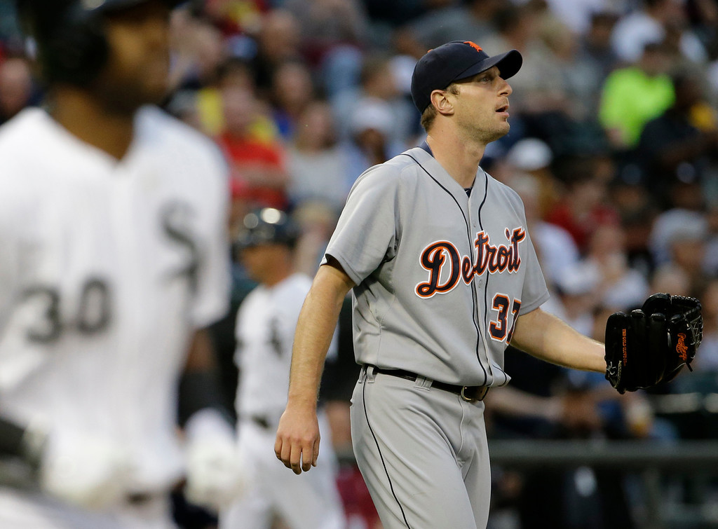 . Detroit Tigers starter Max Scherzer reacts after Chicago White Sox\'s Alejandro De Aza walked to first base during the third inning of a baseball game in Chicago on Thursday, June 12, 2014. (AP Photo/Nam Y. Huh)