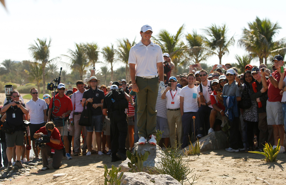 . Rory McIlroy from Northern Ireland reacts on the 9th hole during the second round of Abu Dhabi Golf Championship in Abu Dhabi, United Arab Emirates, Friday, Jan. 18, 2013. (AP Photo/Kamran Jebreili)
