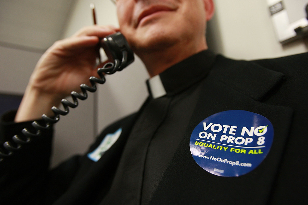 . IRVINE, CA - OCTOBER 16:  The Rev. Dr. Paul Tellstrom (R), pastor of the Irvine United Congressional Church, volunteers at a phone bank to urge Californians to vote no on Proposition 8, which would outlaw same-sex marriages throughout California, in conservative-leaning Orange County on October 16, 2008 in Tustin, California. As same-sex marriages became legal in California on June 16, conservative churches vowed to fight it and are spearheading passage of Proposition 8 which would change the state constitution to recognize only marriages between one man and one woman as legal. Funding for the campaign to pass Prop 8 has dwarfed that of their opponents in large part because of the resources of conservative churches which maintain that homosexuality is sinful.  (Photo by David McNew/Getty Images)