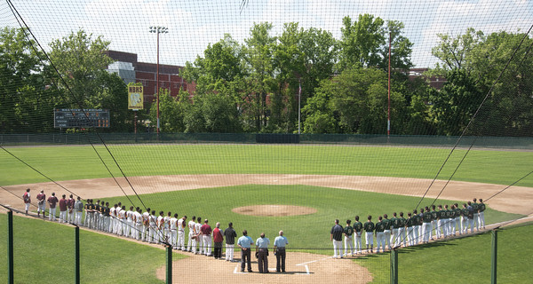 05/30/18 Wesley Bunnell | Staff New Britain baseball defeated Enfield 4-3 with a walk off bases loaded single in the bottom of the 7th in a first round CIAC Class LL tournament game. Teams line up during the National Anthem.