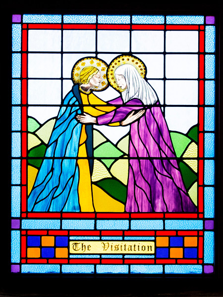 We visit the old prison chapel with its one stained glass reredos.