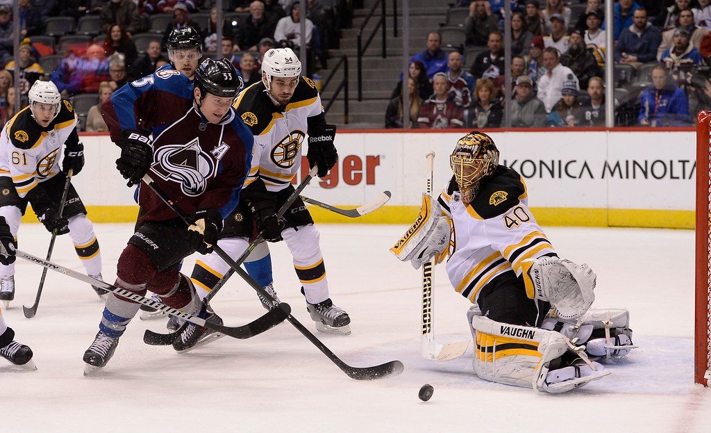 . DENVER, CO - JANUARY 21: Colorado Avalanche left wing Cody McLeod (55) tries to get to the puck as Boston Bruins goalie Tuukka Rask (40) makes the save during overtime January 21, 2015 at Pepsi Center. Colorado Avalanche defeated the Boston Bruins 3-2 in a shoot out. (Photo By John Leyba/The Denver Post)