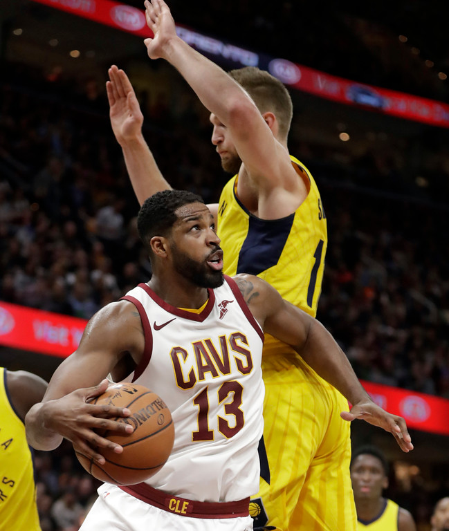. Cleveland Cavaliers\' Tristan Thompson (13) drives around Indiana Pacers\' Domantas Sabonis (11) during the first half of an NBA basketball game Friday, Jan. 26, 2018, in Cleveland. (AP Photo/Tony Dejak)