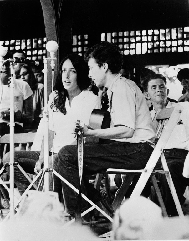 . Folk singers Joan Baez, left, and Bob Dylan perform at the Newport Folk Festival in Newport, R.I. in 1963.  (AP Photo)