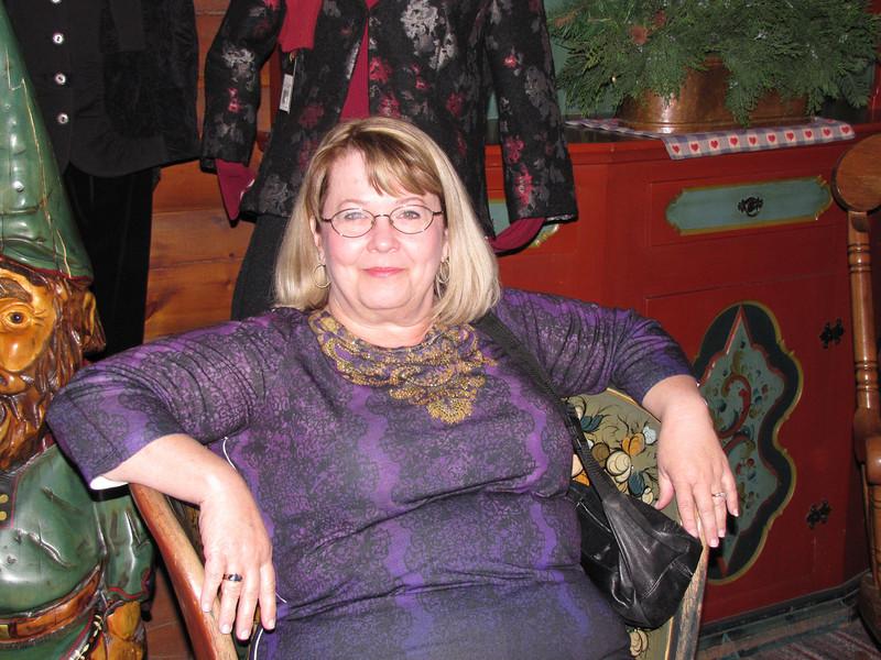 Debby seated in Al Johnson's Swedish Restaurant