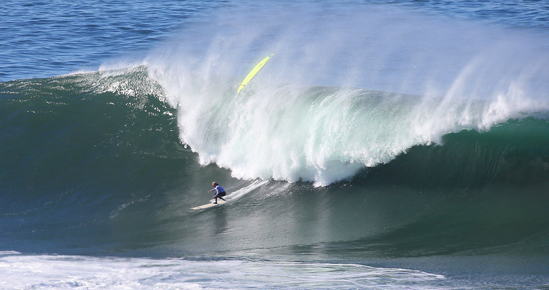 . Ryan Augenstein makes it to the bottom of a wave as Josh Loya wipes out during the third heat of the Mavericks Invitational on Sunday, Jan. 20, 2013 near Half Moon Bay, Calif.  (Aric Crabb/Staff)