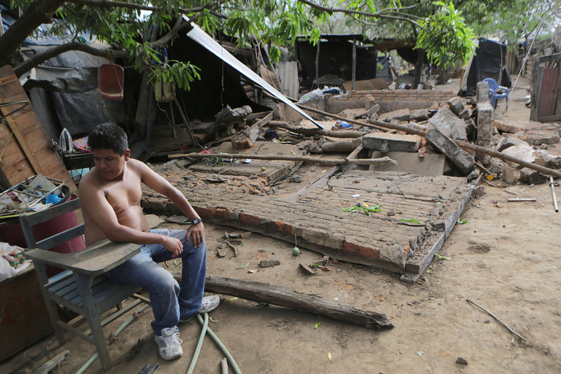 . A child stands by the ruins of his home, destroyed by an earthquake on the eve, in Nagarote, some 40 Km from Managua, on April 11, 2014. A 6.2-magnitude earthquake that struck Nicaragua killed one person, left 33 injured and damaged more than 800 homes, the government said Friday.  (Inti Ocon/AFP/Getty Images)