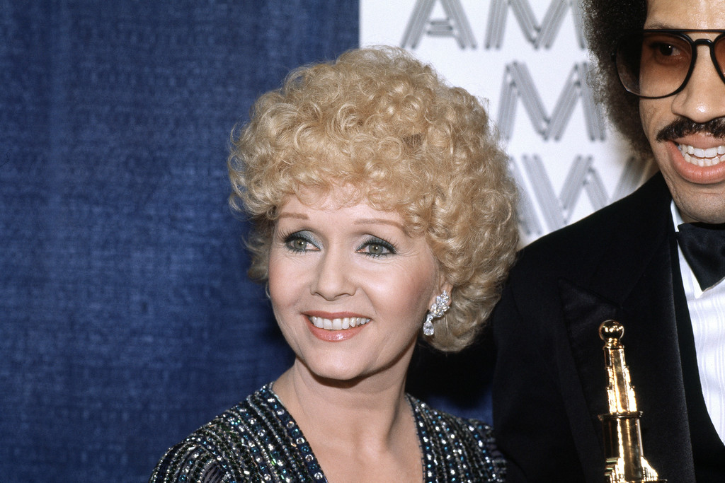 . Actress Debbie Reynolds at the American Movie Awards in Los Angeles on March 15, 1982. (AP Photo/Doug Pizac)