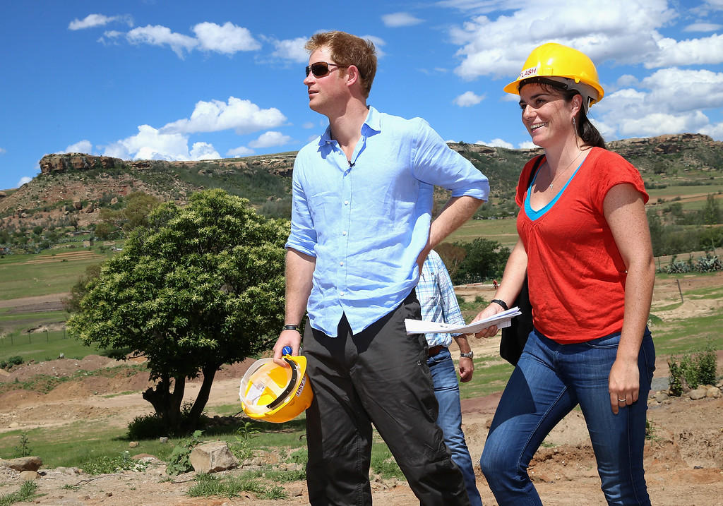 . Prince Harry and Project Manager Catriona Forbes visit the construction site for the new Sentebale Mamohato Children\'s Centre at Thaba-Bosiu on December 5, 2014 in Maseru, Lesotho.  (Photo by Chris Jackson/Getty Images for Sentebale)