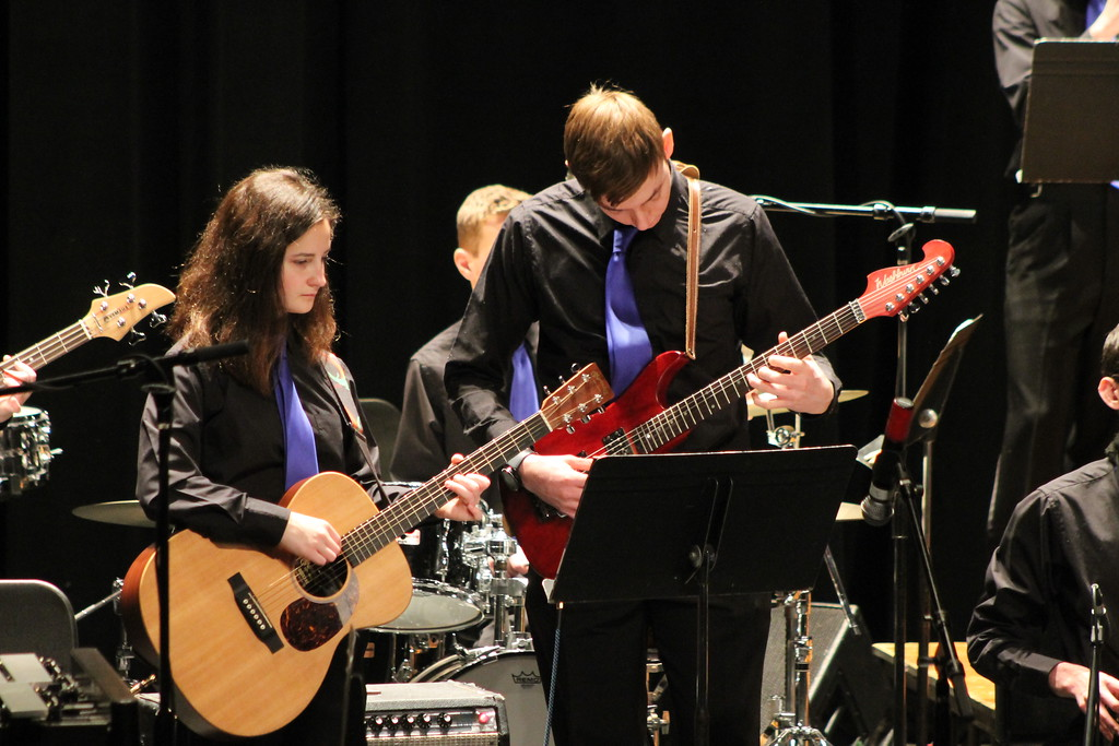 . Sara Formaca and C.J. Bishop  of Wickliffe High School\'s Jazz Band  play guitars during their performance in the Lakeland Jazz festival at Lakeland Community College on March 16. Kristi Garabrandt - The News-Herald