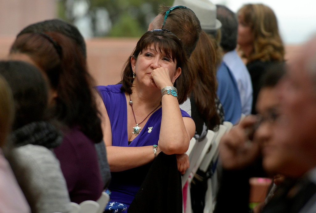 . Glenda Aretxuloeta watches a video presentation during a memorial service for her son Wesley Quinlan and Wiyanna Nelson at the National Center for Atmospheric Research in Boulder, CO September 21, 2013. (Photo By Craig F. Walker / The Denver Post)