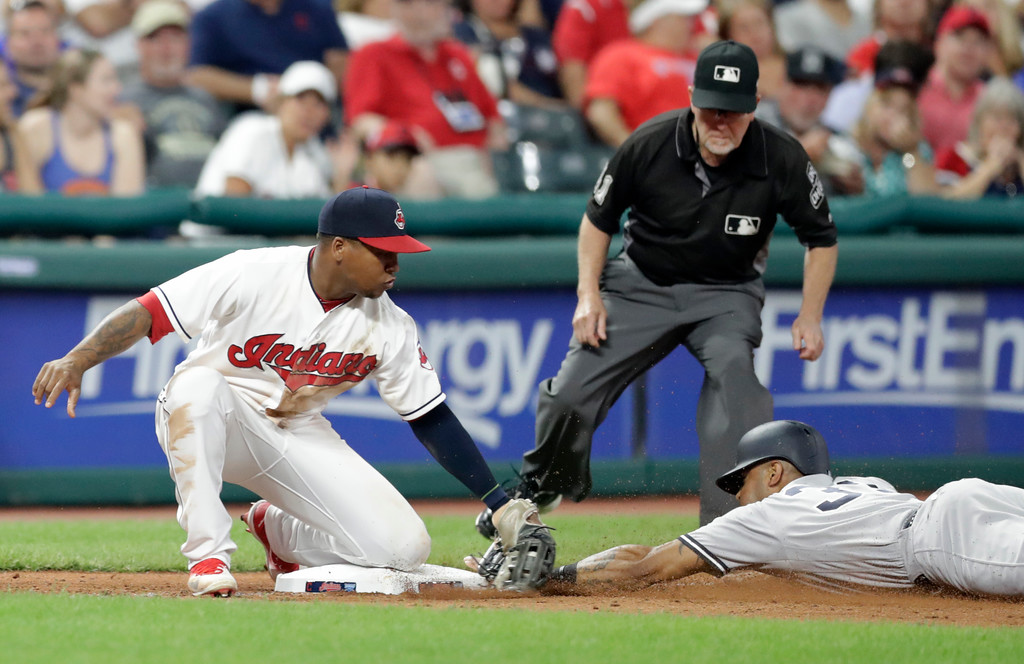 . New York Yankees\' Aaron Hicks steals to third base as Cleveland Indians\' Jose Ramirez is late on the tag in the eighth inning of a baseball game, Thursday, July 12, 2018, in Cleveland. (AP Photo/Tony Dejak)