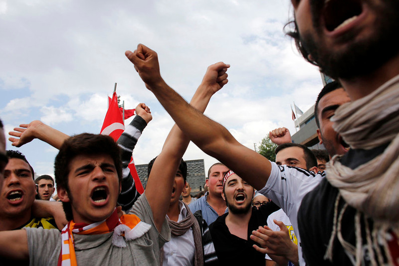 . Demonstrators shout slogans during an anti-government protest at Taksim Square in central Istanbul June 2, 2013. Prime Minister Tayyip Erdogan accused Turkey\'s main secular opposition party on Sunday of stirring a wave of anti-government protests, as tens of thousands regrouped in Istanbul and Ankara after a lull and trouble flared again in the capital. REUTERS/Murad Sezer