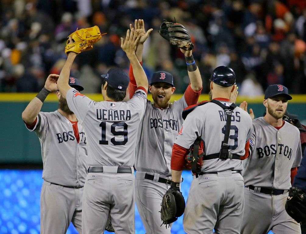 . Boston Red Sox players celebrate with Koji Uehara after the Red Sox defeating the Detroit Tigers 4-3 in Game 5 of the American League baseball championship series Thursday, Oct. 17, 2013, in Detroit. (AP Photo/Matt Slocum)