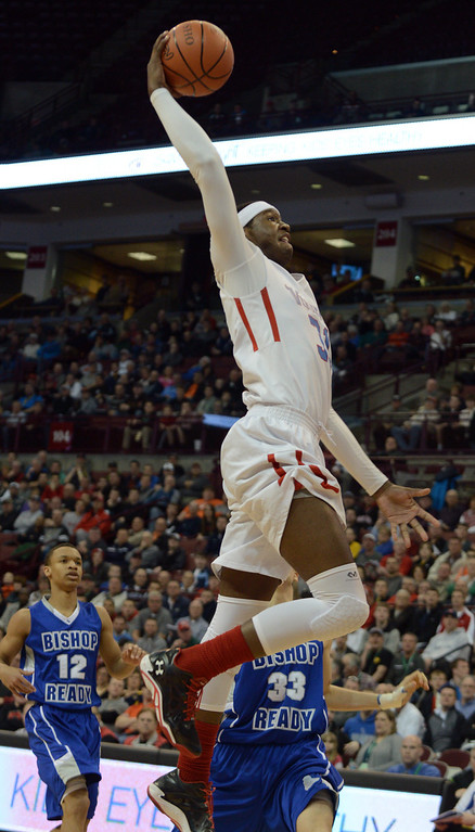 . Duncan Scott/DScott@News-Herald.com VASJ\'s Carlton Bragg skies for an atteempted dunk in the first quarter. Bragg missed the shot but VASJ won the Division III state semifinal on March 21, 55-40, to advance to the state final on March 22.