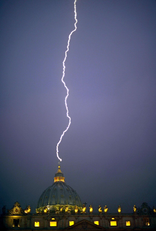. Lightning strikes St Peter\'s dome at the Vatican on February 11, 2013. Pope Benedict XVI announced he would resign as leader of the world\'s 1.1 billion Catholics on February 28 because his age prevented him from carrying out his duties -- an unprecedented move in the modern history of the Catholic Church.       FILIPPO MONTEFORTE/AFP/Getty Images