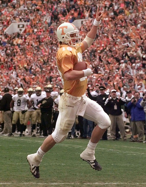 . Tennessee quarterback Peyton Manning crosses the goal line for a third quarter touchdown during Tennessee\'s 17-10 win over Vanderbilt on Saturday, Nov. 29, 1997 in Knoxville, Tenn. (AP Photo/Mark Humphrey)