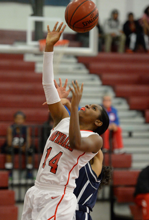 . Lawndale\'s Brittni Scott (14) puts up a shot over Leuzinger in a girls basketball game at Lawndale High Tuesday, December 10, 2013, in Lawndale, CA.  Photo by Steve McCrank/DailyBreeze