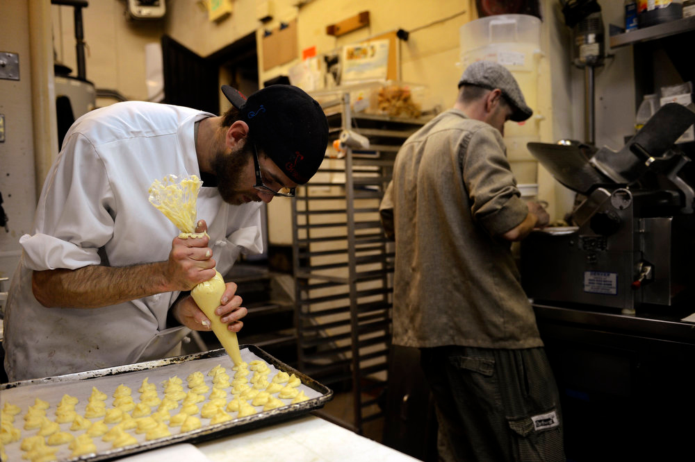 . Strings Restaurant pantry saute chef Brett Daugherty making the last tray of Gruyere cheese balls he will have to make on the last day of service as the Denver favorite closes April 30, 2013 Denver, Colorado. (Photo By Joe Amon/The Denver Post)