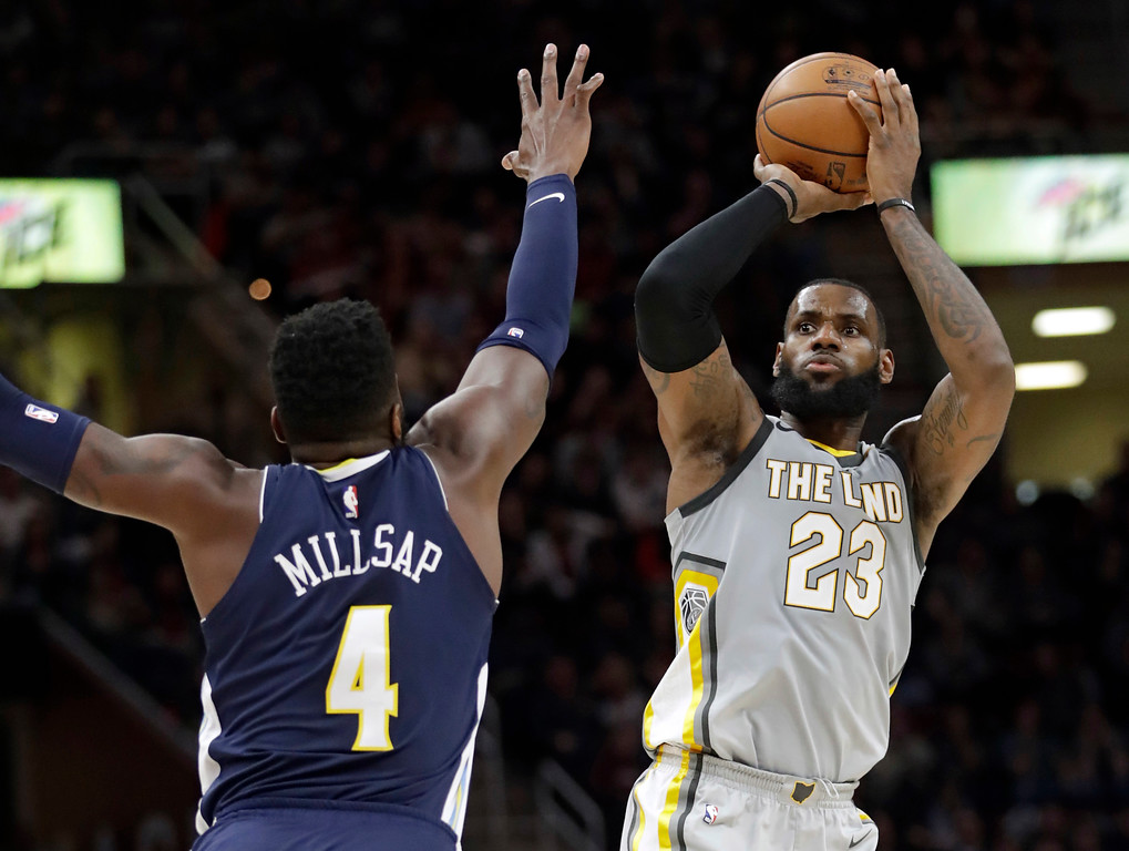. Cleveland Cavaliers\' LeBron James (23) shoots over Denver Nuggets\' Paul Millsap (4) in the first half of an NBA basketball game, Saturday, March 3, 2018, in Cleveland. (AP Photo/Tony Dejak)