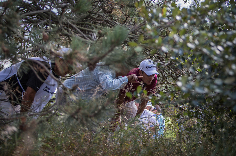 Justin Rose discusses his options with a PGA rules official after hooking his ball in the high brush off the ninth tee during the opening round at the BMW/Western Open on Thurs. Sept. 12, 2013. WGA Photo/Charles Cherney