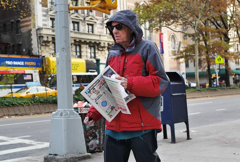 SENIOR WITH NEWSPAPER