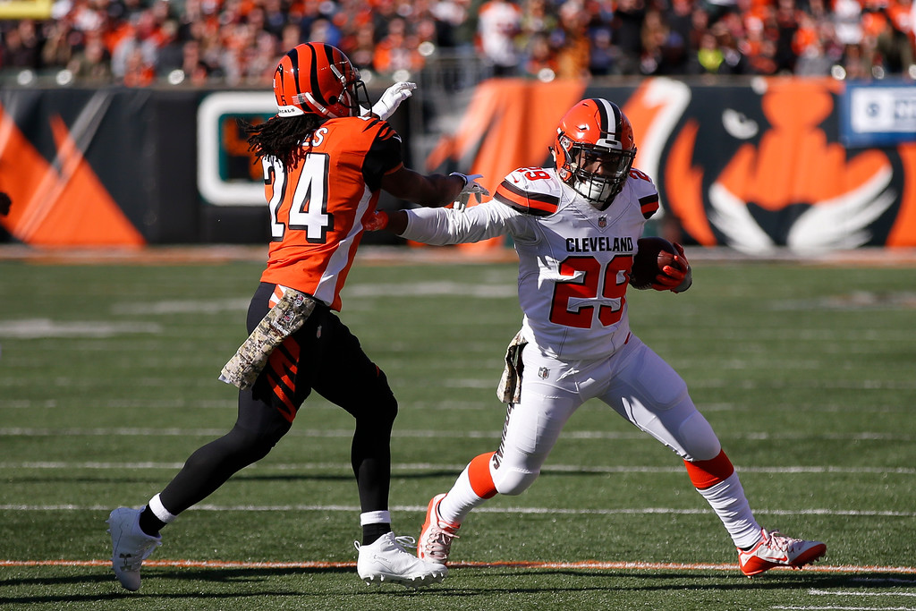 . Cleveland Browns running back Duke Johnson (29) runs the ball against Cincinnati Bengals cornerback Adam Jones (24) in the first half of an NFL football game, Sunday, Nov. 26, 2017, in Cincinnati. (AP Photo/Gary Landers)