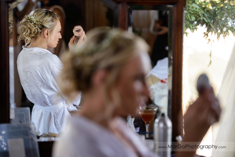 bride cheking her hair in the mirror