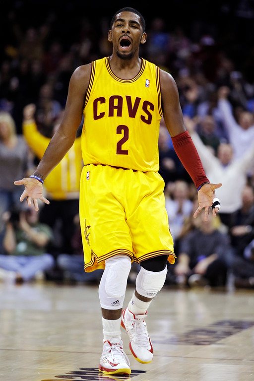 . Cleveland Cavaliers\' Kyrie Irving celebrates after making a 3-pointer against the Los Angeles Lakers in the second quarter of an NBA basketball game, Tuesday, Dec. 11, 2012, in Cleveland. (AP Photo/Mark Duncan)