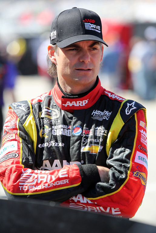 . DAYTONA BEACH, FL - FEBRUARY 20:  Jeff Gordon, driver of the #24 Drive To End Hunger Chevrolet, stands in the garage area during practice for the NASCAR Sprint Cup Series Daytona 500 at Daytona International Speedway on February 20, 2013 in Daytona Beach, Florida.  (Photo by Jerry Markland/Getty Images)